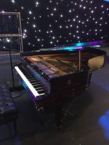 Rosewood Steinway B on a stage